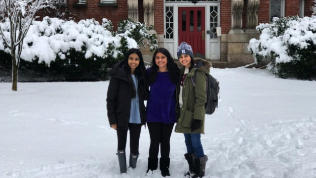 The author and her two roommates stand in the snow in front of their future home at Harvard.