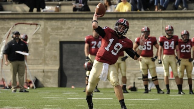 Harvard's Colton Chapple throws a football to an out-of-frame receiver.