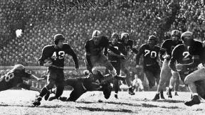 Harvard at Army, 1948: The Black Knights won, 20-7. The ball carrier is Chuck Roche '50.