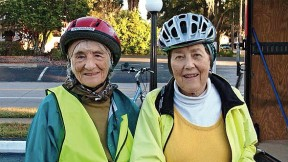 While cycling the East Coast Greenway, Linda Cabot Black and Elizabeth Brody pause for some Florida sunshine.