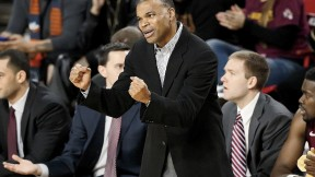 """Head coach Tommy Amaker says that to win Harvard's fifth straight conference title, his players must """"rely on each other."""""""
