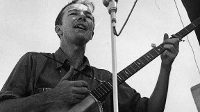 Pete Seeger, shown singing in an undated photo, traveled light, always ready to make music.