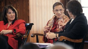 U.S. district judge Nancy Gertner (left) listens as Linda Greenhouse '68, formerly the Supreme Court reporter for the <em>New York Times,</em> questions Supreme Court Justice Ruth Bader Ginsburg.