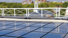 Harvard is already trying many green initiatives; it will need to do much more to meet its new greenhouse-gas emissions goal. Above: solar panels on the roof of the Business School's Shad Hall.
