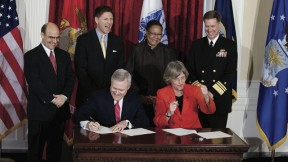Done deal. U.S. Secretary of the Navy Ray Mabus and President Drew Faust sign the ROTC agreement as (left to right) Vice President and General Counsel Robert Iuliano, Assistant Secretary of the Navy Juan M. Garcia III, Dean of Harvard College Evelynn Hammonds, and Vice Admiral Mark E. Ferguson III look on.