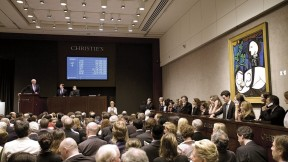 The 1931 Picasso painting <i>Nude, Green Leaves and Bust</i> being auctioned at Christie's in 2010. The sale price of $106 million set a world record.