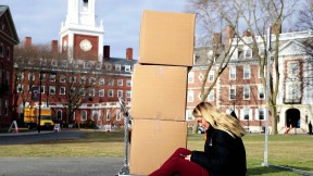 Photograph of student moving out of Eliot House for coronavirus social distancing