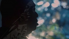 A still image from the film, This is Love, showing Rudy Love in shadowed profile