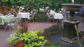 Request a spot on Stellina's Italian-style back terrace.