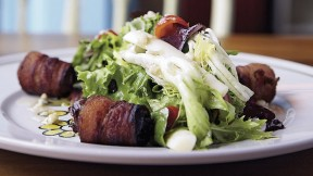 Tangy greens with bacon-wrapped dates