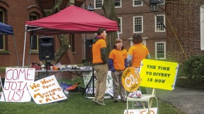 Advocates of divesting fossil-fuel investments protest at the president's office at Massachusetts Hall.