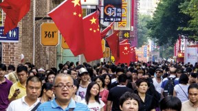China—both a Communist Party state and a consumer society (as in this holiday street scene in Guangzhou)—is also the setting for a billion-plus citizens' pursuit of their own dreams.