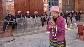 A Tibetan woman praying at the Boudhanath Stupa, near Kathmandu