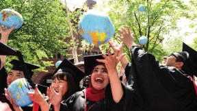 Kennedy School mid-career-degree celebrants (from left) Tadahiro Ikemoto, M.P.H. '14, M.P.A. '15, of Japan, Zhuldyz Bakytzhanova, M.P.A. '15, Sahar Albazar, M.P.A. '15, of Egypt, and Alvaro Henzler, M.P.A. '15, of Peru