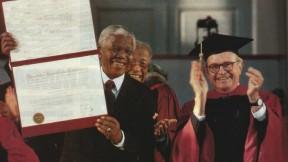 Photograph of Nelson Mandela receiving honorary degree and University Marshal Rick Hunt