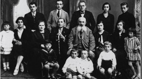 The Levy family in 1928; Jacob holds the cane. Only he and Rivka Levy (far left, flounced dress) survived the Nazis.