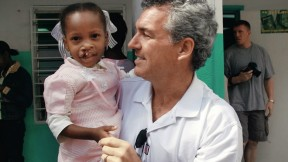 "Brian Mullaney with a Haitian patient before her surgery this past February. Smile Train has provided roughly 160 surgeries in Haiti and recently launched ""Cleft-free Haiti"" to completely eradicate cleft there."