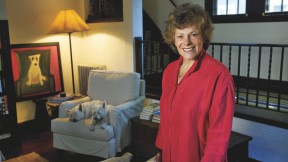 Ellen Langer at home, with her dogs and her own painting of a dog.