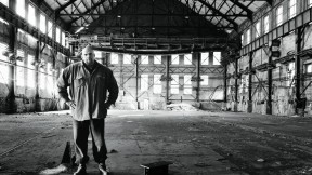 John Fetterman stands inside the defunct Carrie Furnance Works (1884-1982), which he hopes will be turned into  a museum and national park down the river from Braddock.