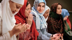 Wearing hijab, Muslim women from the United States and around the world meet in Manhattan in 2006 during the Women's Islamic Initiative: Spirituality and Equity conference to discuss the issues and problems they face.