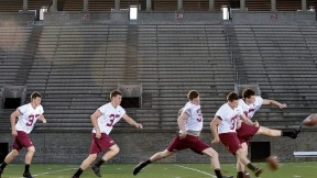 """In Harvard Stadium, David Mothander practices a kickoff, using the ubiquitous """"soccer-style"""" kicking technique. Scroll down for a <a href=""""#placekick"""">video.</a></p>"""