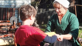 Traditional artisans, such as spinners, demonstrate their skills at Strawbery Banke.
