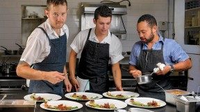 "Chef/owner Alex Crabb shares the open kitchen with fellow cooks Tyson Wardwell and Nathan ""Lazer"" Phinisee."