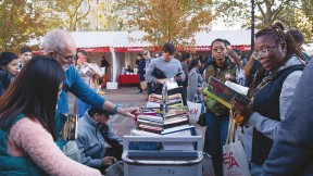 People perusing books outside at the Boston Book Festival