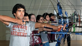 Samuel Saidel-Goley (foreground) and Archery Club colleagues draw their bows.