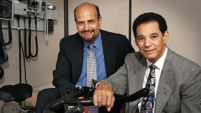 James Katz (left) and Bob Nadelberg with an indoor bicycle at their offices