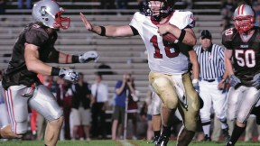Quarterback Andrew Hatch's forte is passing, but Brown's defenders kept him on the run in a 29-14 blowout.