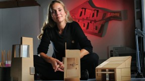 Elizabeth Whittaker, at her office in Boston, with basswood architectural models for residential and commercial structures