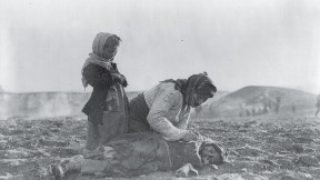 The endless pain of the Middle East: woman and dead child near Aleppo, Syria (undated)