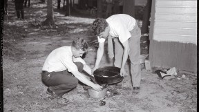 Forensic pioneer Joseph T. Walker (at left) collects blood and scraps of flesh from the bathtub drain of a 1936 murder victim.
