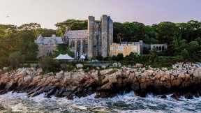 Majestic twentieth-century stone castle perched on Gloucester coastline