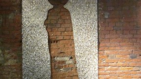 The mosaic <i>Absence</i> (2012) on a wall in Moscow
