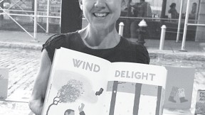 Claudia Bedrick displays one of Enchanted Lion's books.