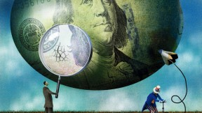 Cracks appear in a balloon decorated like a $100 bill as Uncle Sam fills it with a bicycle pump