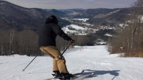 Skier in action at the top of a snow of snow-covered Berkshire East mountain