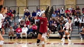 Harvard volleyball player Sandra Zeng setting a ball during a game