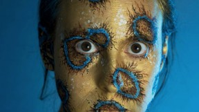 Shelby Meyerhoff's photographic self-portrait of her head and shoulders transformed with body paints into a blue-ringed octopus
