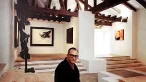 In a 1966 image taken in the Museum of Abstract Spanish Art in Cuenca, Zóbel holds one of his sketches; his painting <em>Ornitóptero</em> hangs behind him. At left is <em>Homenaje a Vasarely II,</em> a sculpture by Amadeo Gabino; the painting at far right is <em>Barrera con rojo y ocre,</em> by José Guerrero.