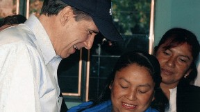 Julio Frenk, as Mexico's minister of health, administers oral polio vaccine to a baby in a rural  community during National Health Week in 2005.