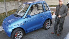 Jeffrey Leonard proudly drives a REVA electric car.