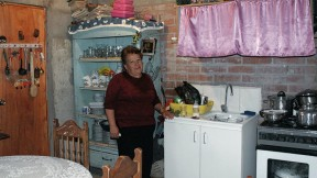 Rosa Estrella Ortega Roa has big plans for the unit where she lives with her two-year-old grandson. Although the walls and ceiling of her kitchen are still unfinished... [click the images below for more]