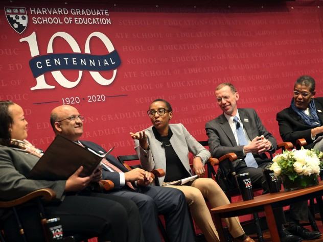 Five Harvard deans sit on stage in a panel.