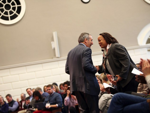HGSE dean Bridget Terry Long and President Lawrence S. Bacow shake hands.