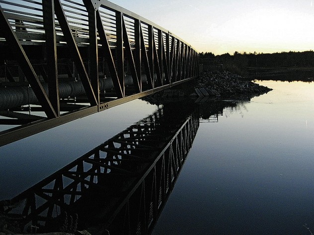 The Eastern Trail's bike and pedestrian bridge respects the animal and bird life of the marshlands in Scarborough, Maine.