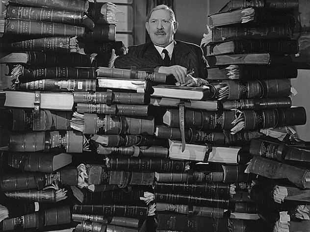 (At left) Bruce Ingram, publisher of the <i>Illustrated London News,</i> posed in 1950 with bound volumes of every edition of the paper since 1842.