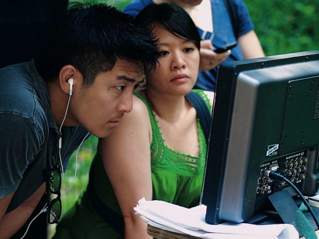 Louie and director Tze Chun check a monitor during production.